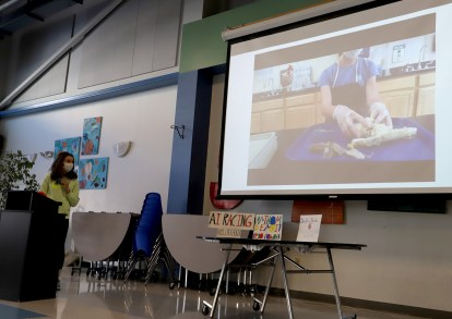 Shealyn Brochu shows a video where she dissected a pig heart to show the innerworkings of the organ.