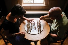 Francelle Carapetyan and husband Peter Bixby playing chess
