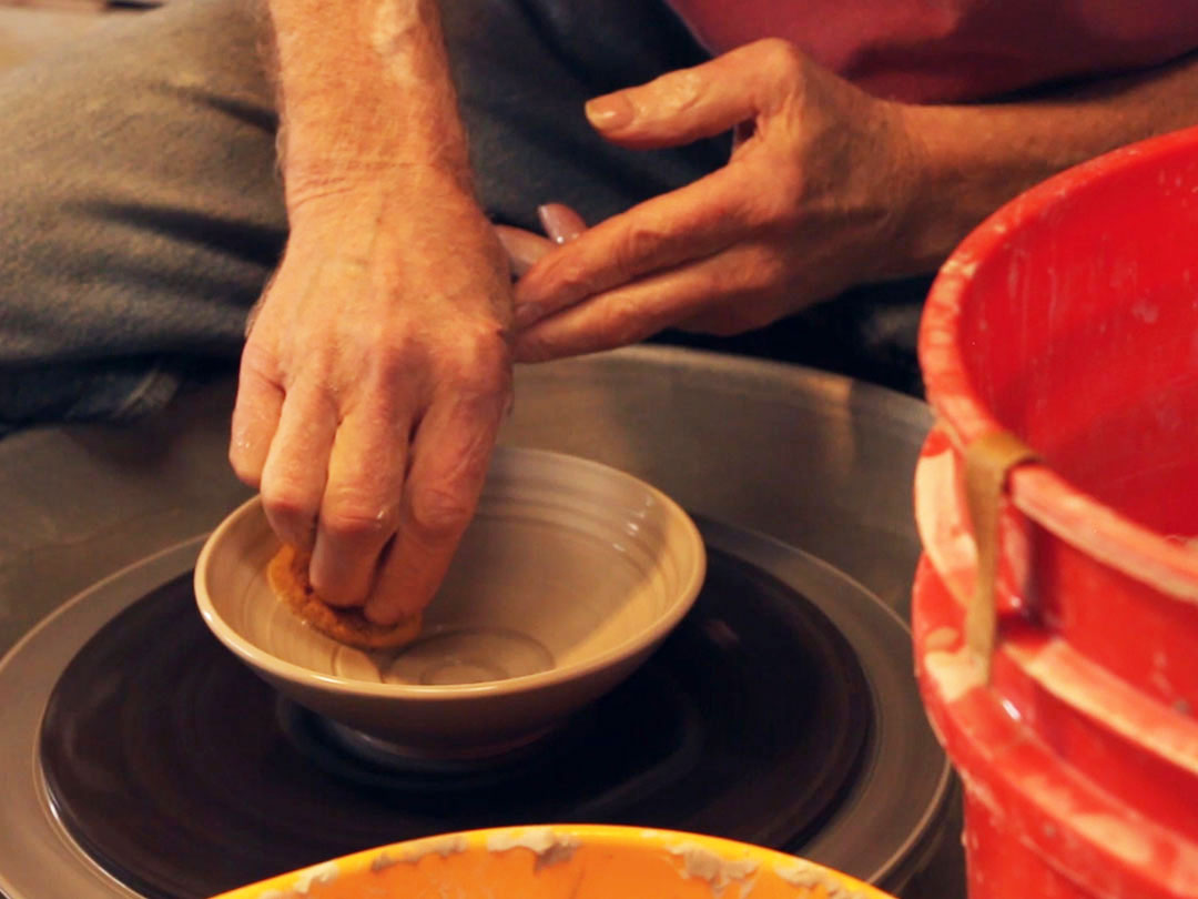 Learn the relaxed yet controlled strength needed to throw clay on the wheel.