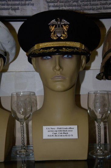 US Navy Field Grade officer's service cap with black cover worn by Capt. Cole Black, POW 06-21-1966 to 02-12-1973.