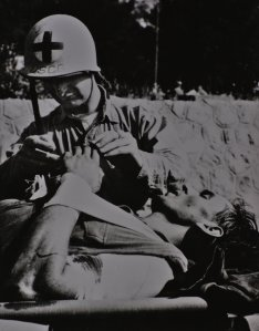 Coast Guard Corpsman giving aid at Normandy.