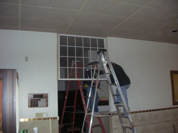 Installing the 100 year old window.