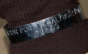 LCDR Porter Halyburton's POW bracelet was placed on his display by a museum visitor.