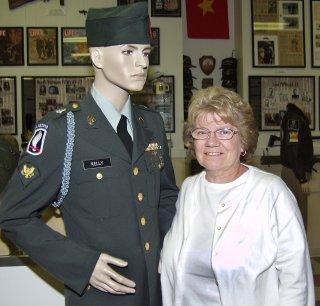 Betty Kelly Pelton with her brother's Vietnam War uniform.