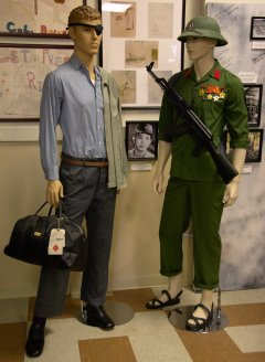 Lt. Col. Lew Shattuck, USAF. POW 7-11-66 to 02-12-73 wearing his original prison release uniform and Hoang Doang, North Vietnamese officer wearing his NVA period uniform at release.