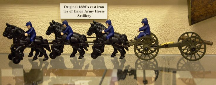 Original late 1870's to early 1880's child's cast iron toy of a Union Cavalry Artillery set of six horses, with riders on three, and two drivers riding the caisson towing the artillery piece.