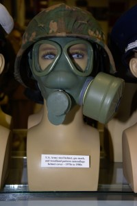 US Army steel helmet, gas mask, and woodland pattern camouflage helmet cover from the 1970s to 1980s.