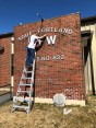 Removing the VFW lettering from the building