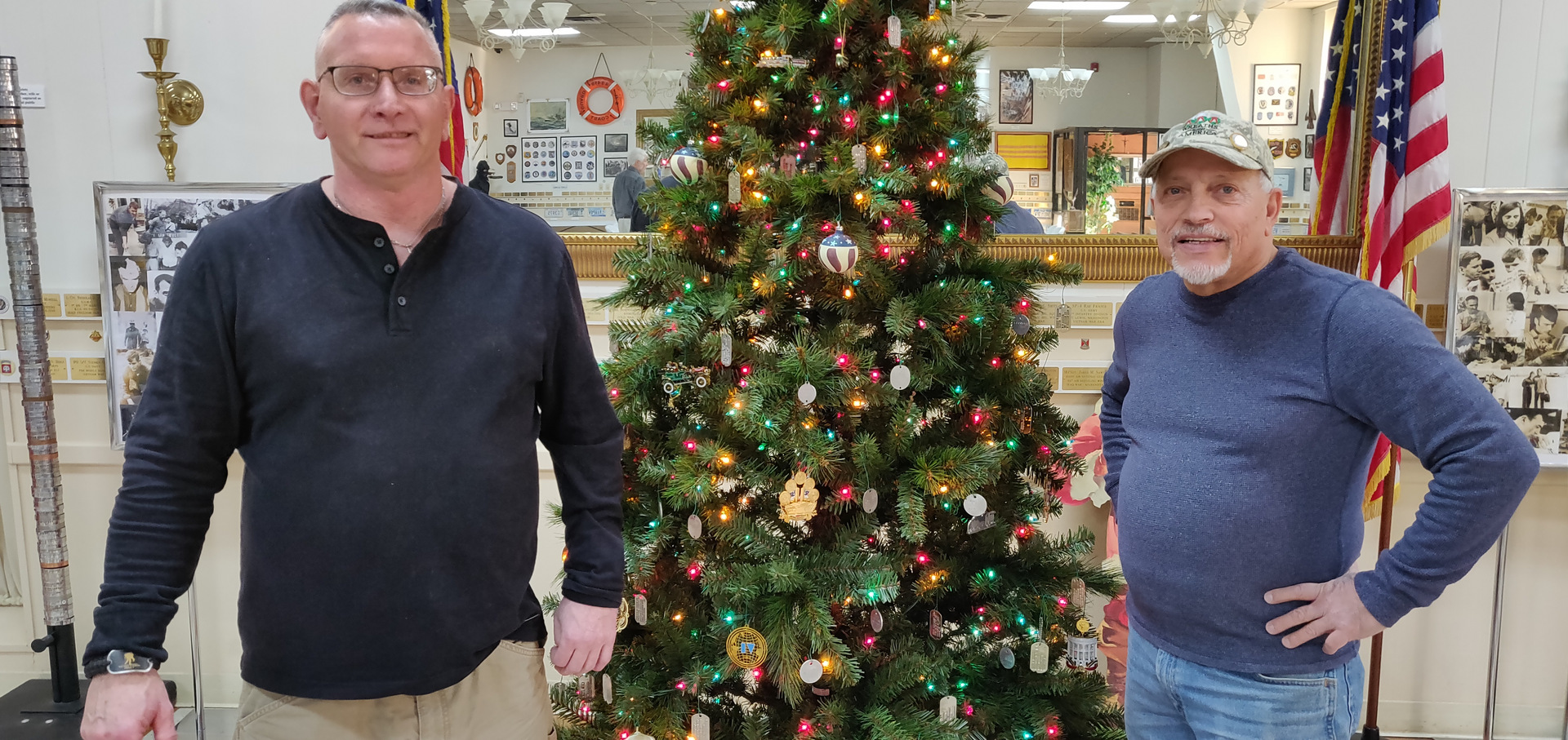 Shawn Withers and Peter Maestre with the 2019 Museum Christmas Tree