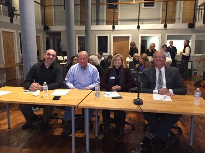 The judges: Adam Nyhan of Opticliff Law; Grant Lewis, a SCORE mentor; Gigi Guyton of New Ventures; and Charles Petersen, CEO of Biddeford Savings Bank.