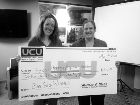 Maddie Purcell (left), founder of Fyood Kitchen, receives a check for $250 after winning the November Big Gig event.