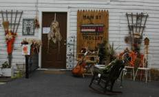 Guitar, scarecrow, corn, chairs and more for sale at the Trolley.