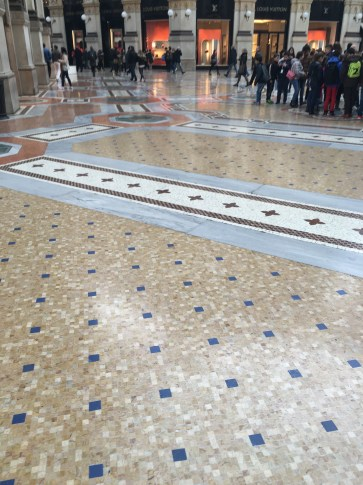 The incredible mosaic floors that cover the Piazza del Duomo.