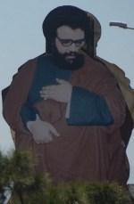 Al-Mussawi. Reclamebord in de Bekaa-vallei.