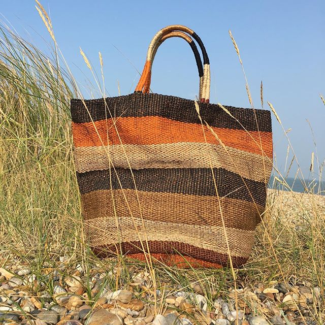 Hand woven jute beach bag on Suffolk beach