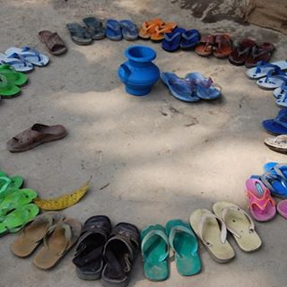 No shoes allowed in class - view outside primary school in rural Bangladesh