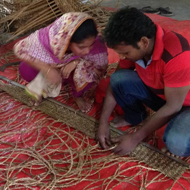 Our expert seagrass weaver Rezaul teaching a new producer how to make our hogla floor mats