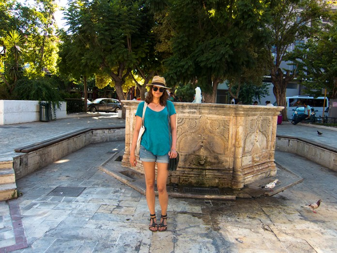 Maja in front of a fountain in Chania