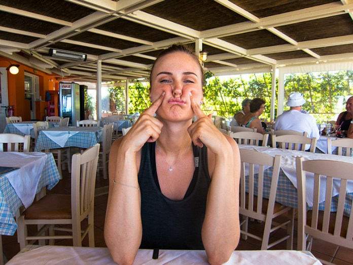 Maja making a grimace in a restaurant