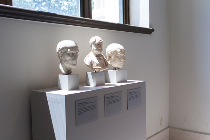 Three marble busts inside the metropolitan museum of art