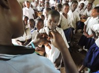 CHW Winner teaching about personal hygiene and cholera prevention at primary school