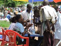 CHWs teaching at a local market about cholera prevention