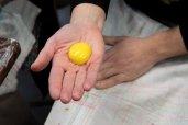 Passing the yolk from hand to hand till it's ready.
