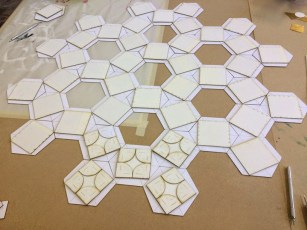 The smaller pieces were laser-cut in mount board. One layer to be gilded or painted...