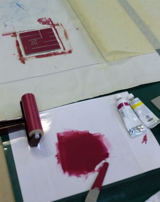 Printing with a hand-carved lino stamp.