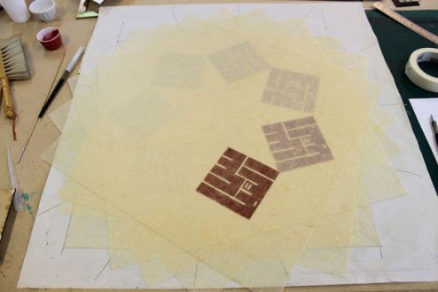 Arranging the layers to form a perfect sevenfold configuration (no small task!)