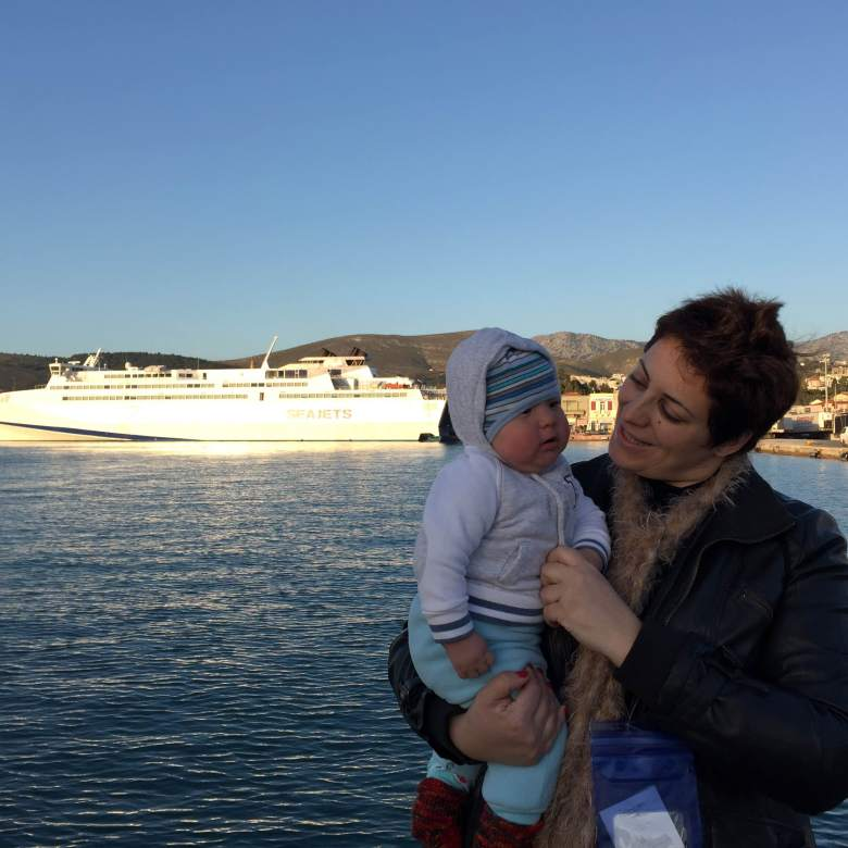 Antonia with a refugee baby in Chios