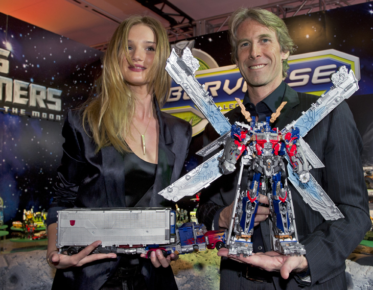 """Transformers: Dark of the Moon,"" star Rosie Huntington-Whiteley and Michael Bay, director, look at new ""Transformers Ultimate Optimus Prime"" at Toy Fair in New York"