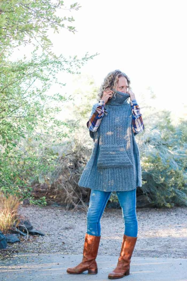 Minimalist crochet poncho pattern that is perfect to pair with leather boots and jeans for a DIY fall outfit idea. The turtleneck cowl and pocket add an extra dose of cozy!