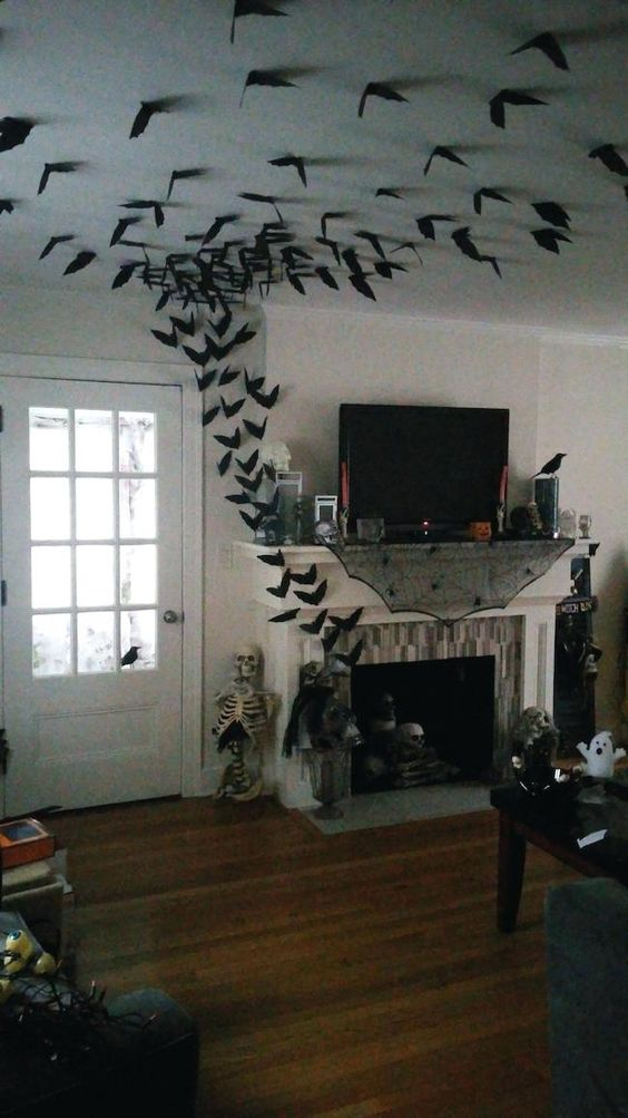 Image of paper bat decorations around a fireplace