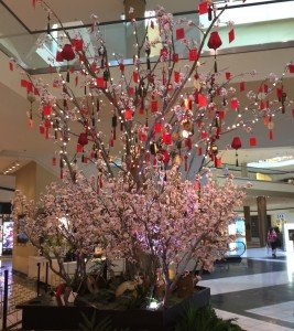 Make Be-Leaves' custom artificial Cherry Blossom Trees pictured at the complex two-floor mall display in the Beverly Center in Beverly Hills. Trees are decorated with small Chinese lanterns and other iconic Chinese decorations.