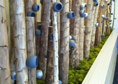 Natural yucca wood poles with attached natural pods, painted to coordinate with the carpeting at the Renaissance Philadelphia Airport Hotel.