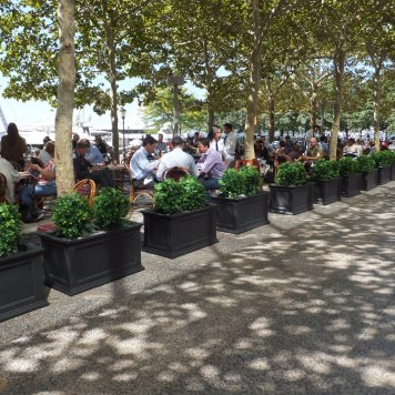 These custom boxwood trees create a dramatic and sophisticated seating area for guests enjoying the view of Lady Liberty.