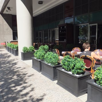 Additional plantscaping defines the outdoor seating area at PJ Clarke's on the Hudson.