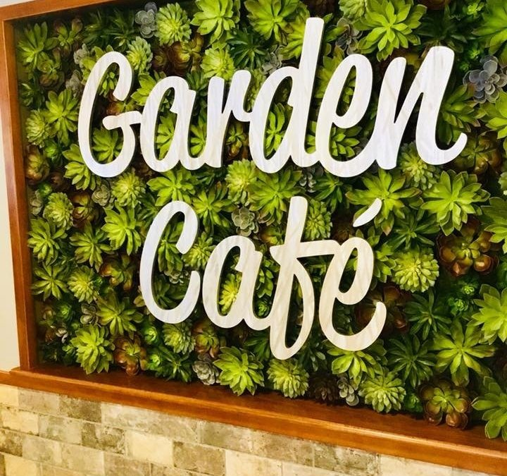 Faux Green Walls with Signage and Lighting