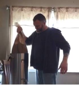 Big Robb draining wort from brew bag