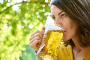 woman drinking a blonde ale home brew