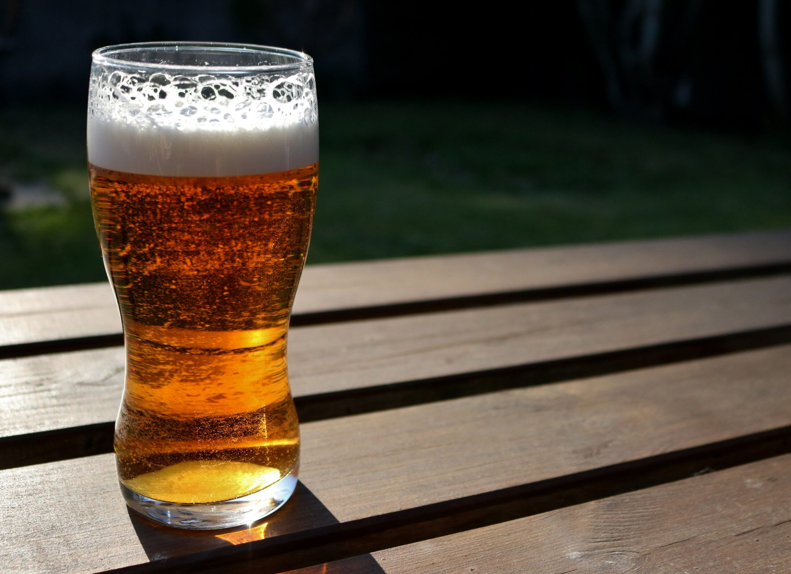 A Pale Ale Beer brewed on electric biab system sitting on picnic table