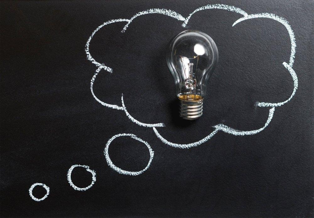 Blackboard with idea bubble in chalk