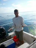 Make It So Key West Boat Charters - Todd holding 2 yellowtail snappers