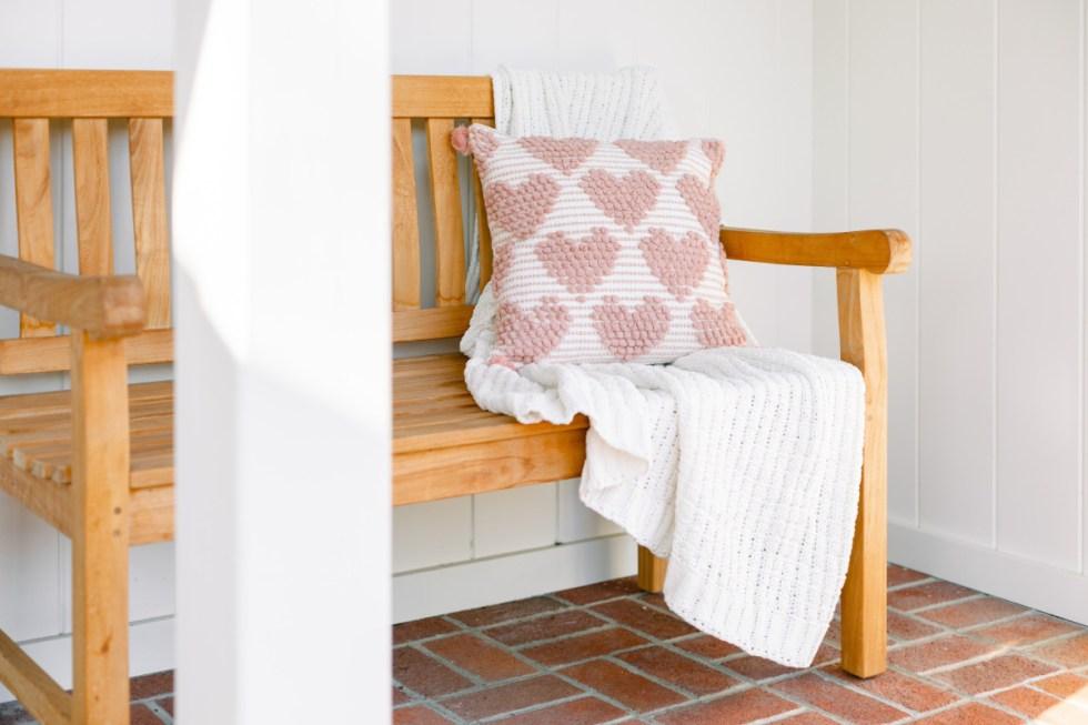 Teak bench with valentine pillow
