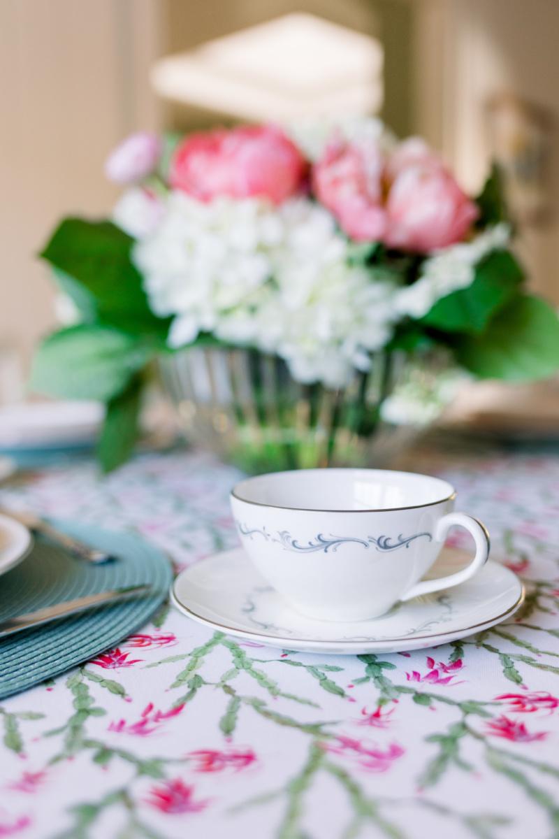 Floral arrangement and tea cup