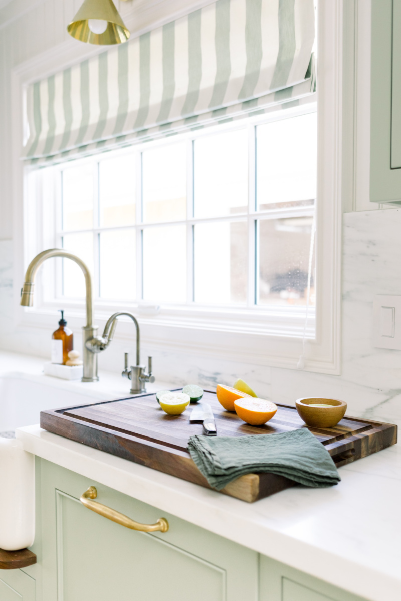Kitchen faucet and cutting board
