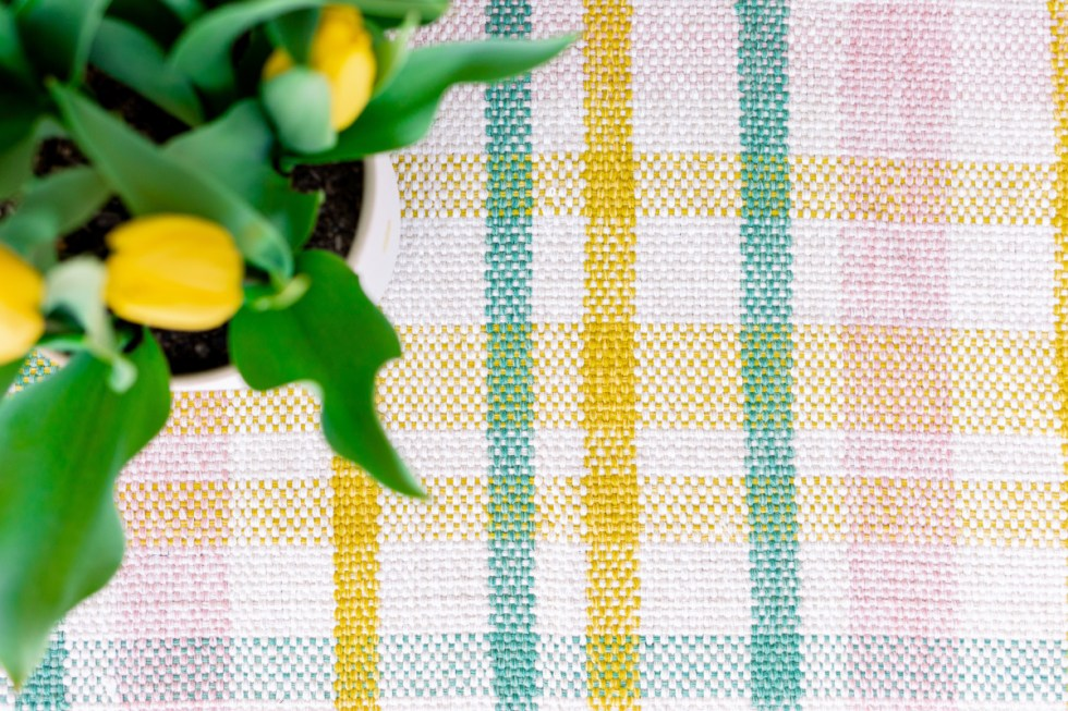 Plaid pastel mat and yellow tulips
