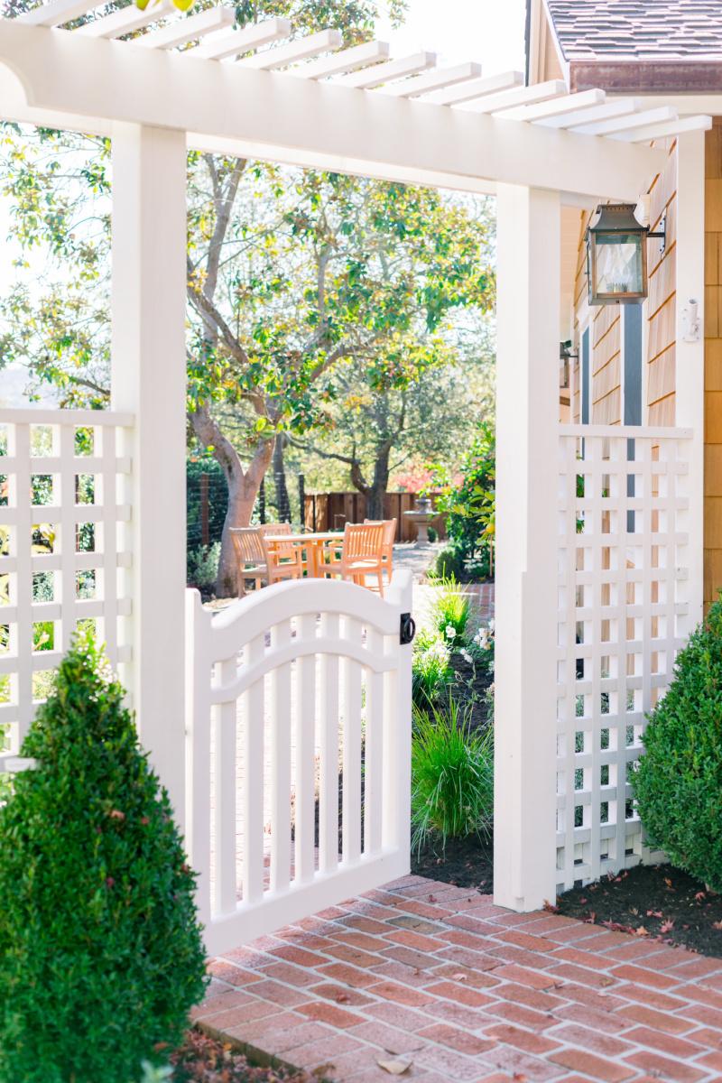 White trellis fence, arbor and gate