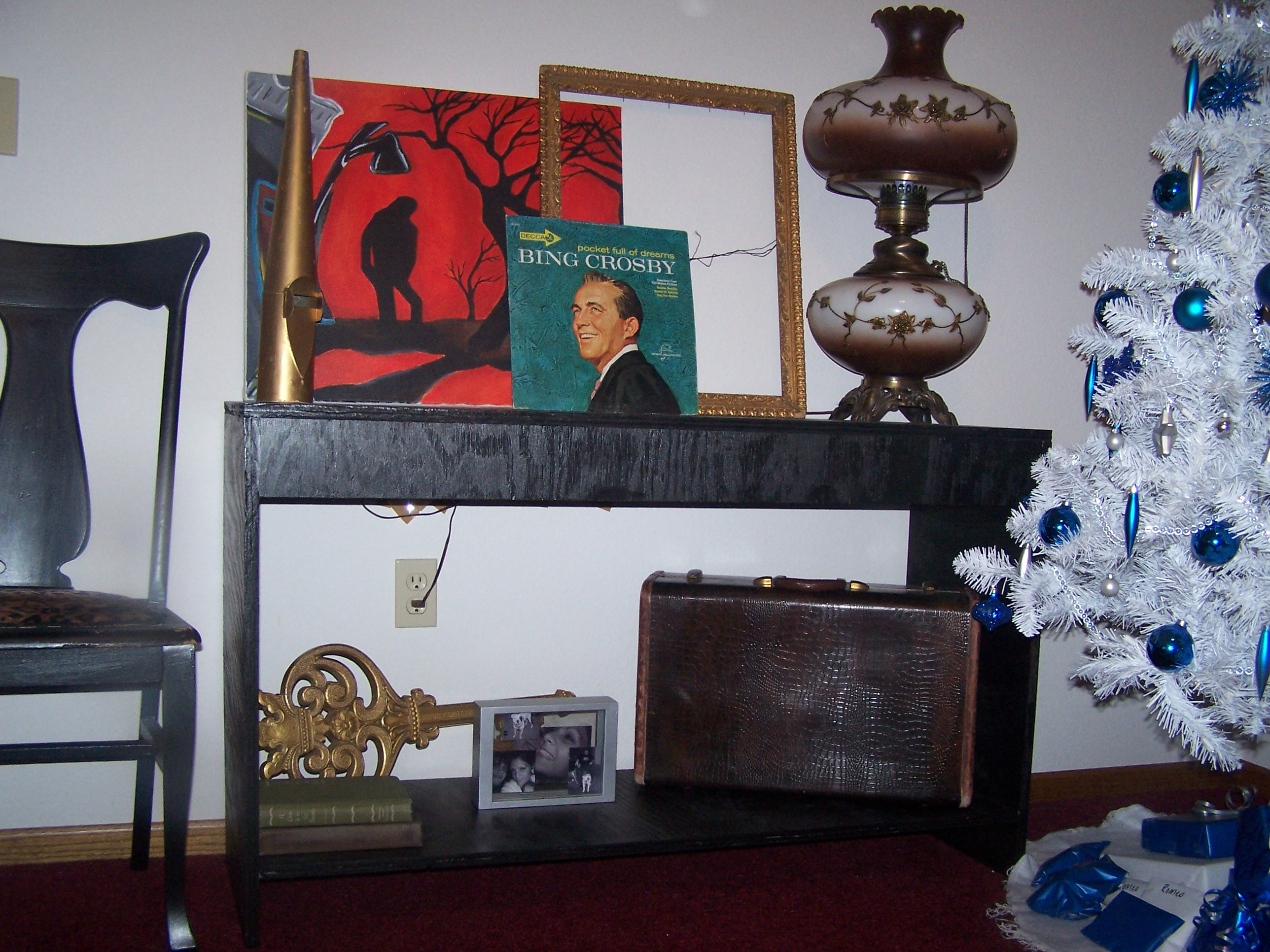 This is the close up of the table that Tony made.  The lamp is an antique from my Grandparents.  The red painting is another original by Ryan Foster.  Some other random fun odds and ends up there too.